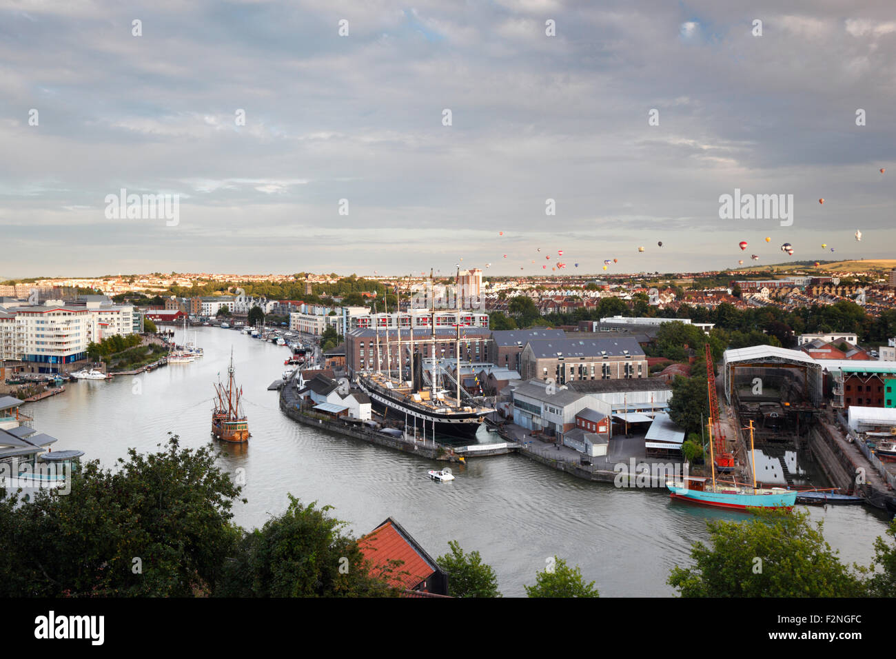 Hot Air Balloons over the Floating Harbour, Bristol. UK. The Matthew sails past the SS Great Britain. - Stock Image