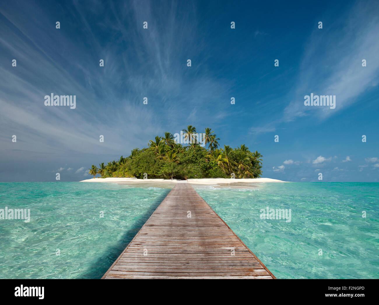 Wooden dock walkway to tropical island Stock Photo