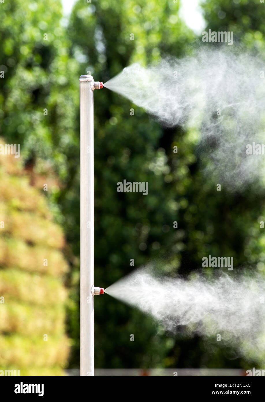 Outdoor vaporizer for refreshing people in summertime - Stock Image
