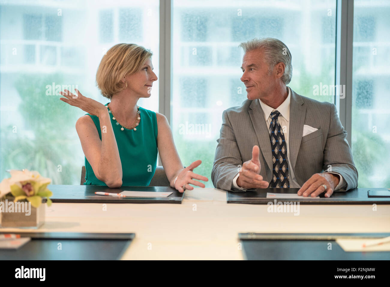 Caucasian business people talking in meeting Stock Photo