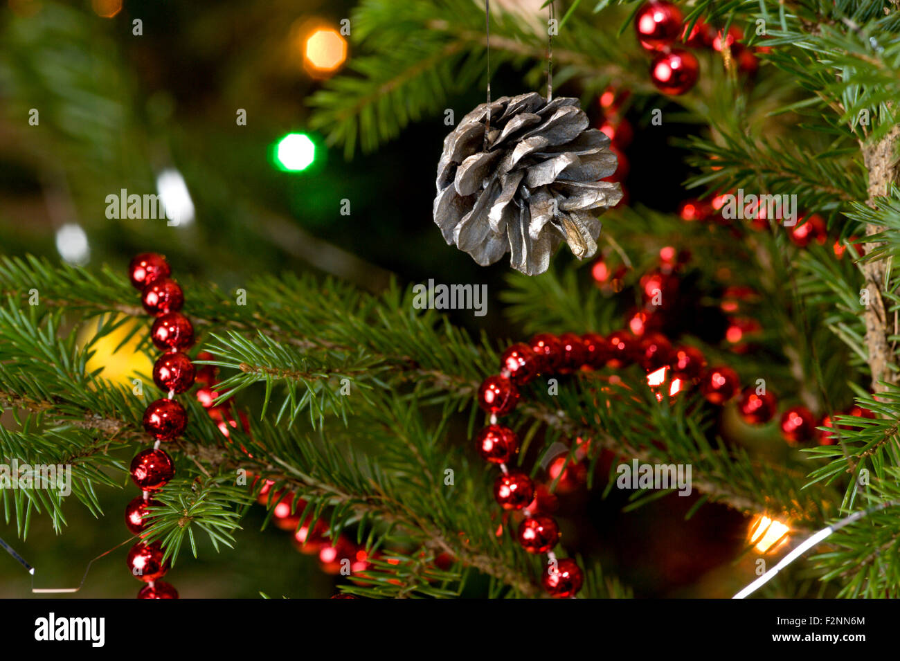 A Traditional Christmas Tree Decoration Using A Sprayed Pine Cone And Stock Photo Alamy