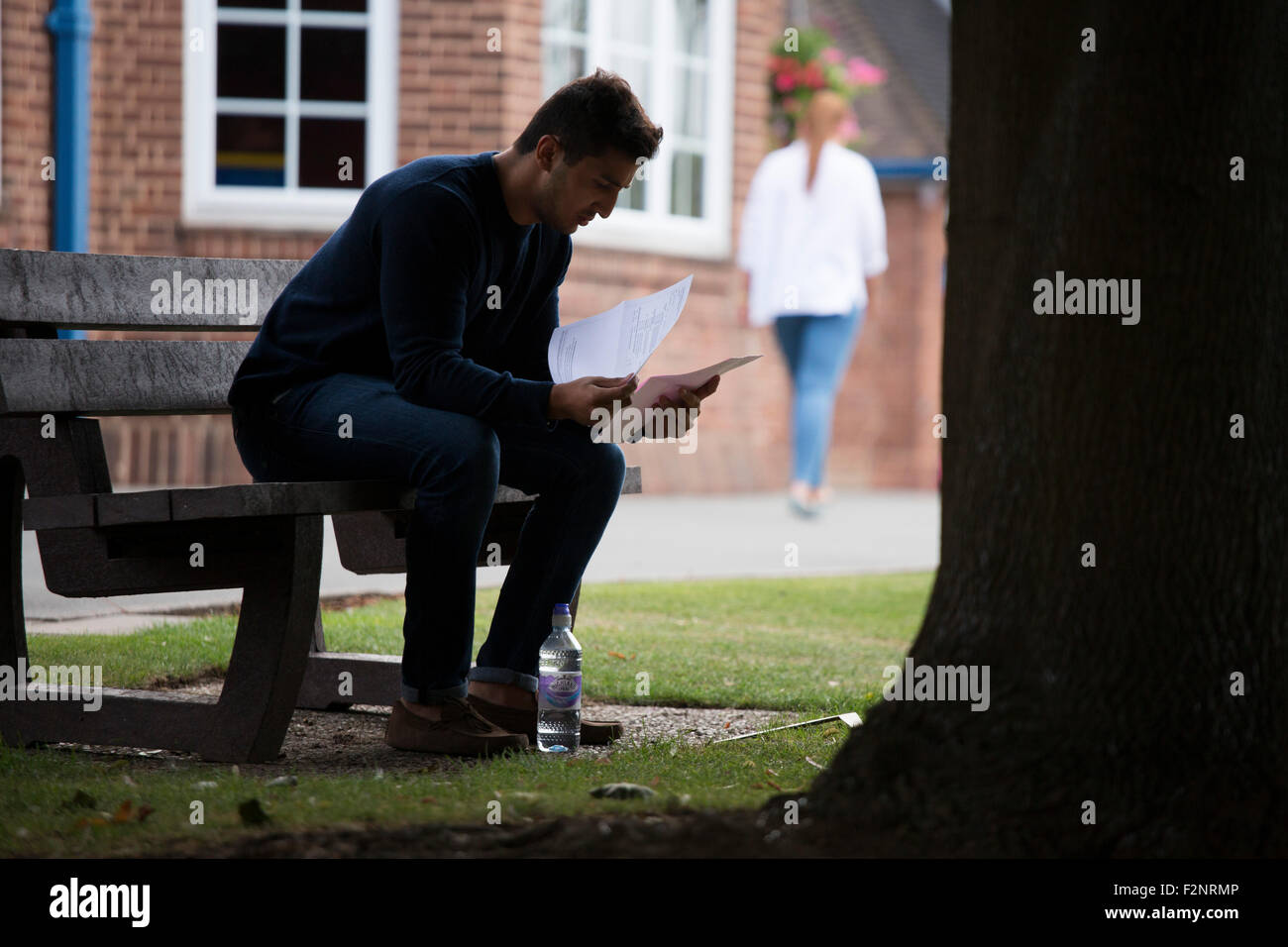 A student reads his A Level results after they have just been announced - Stock Image