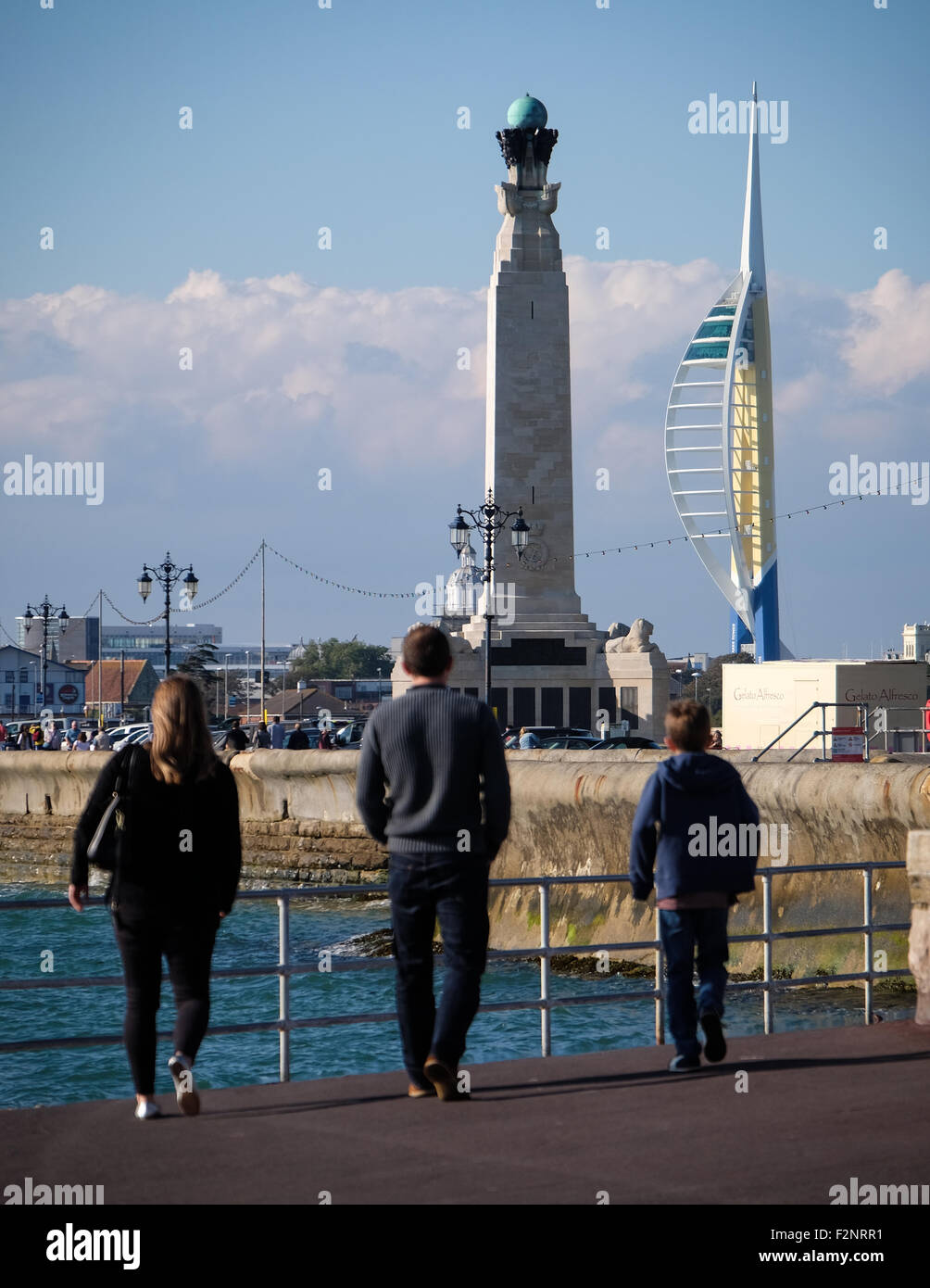 People enjoying the sunny weather on Southsea seafront in Portsmouth Stock Photo