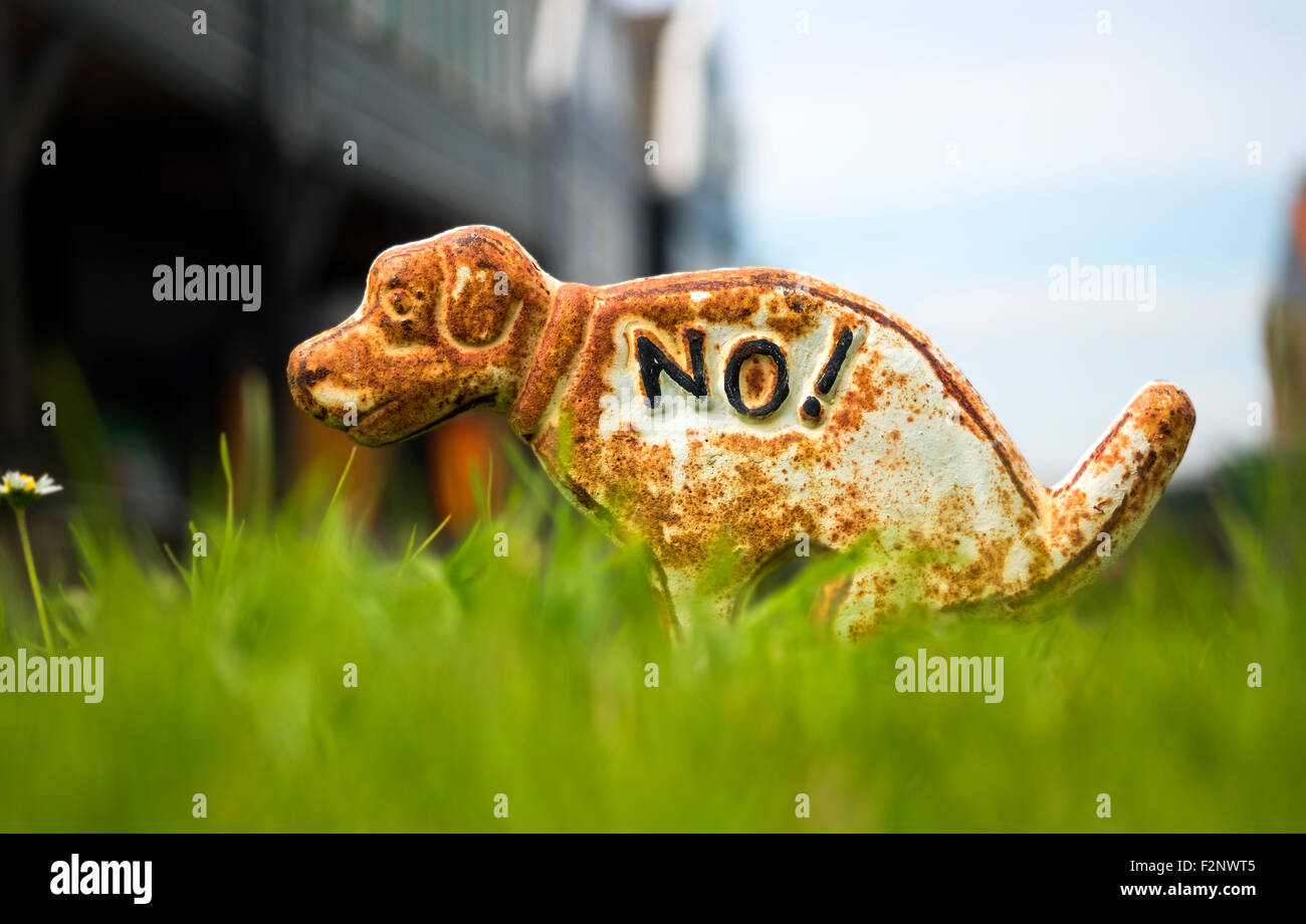No dog mess notice sculpture - Stock Image