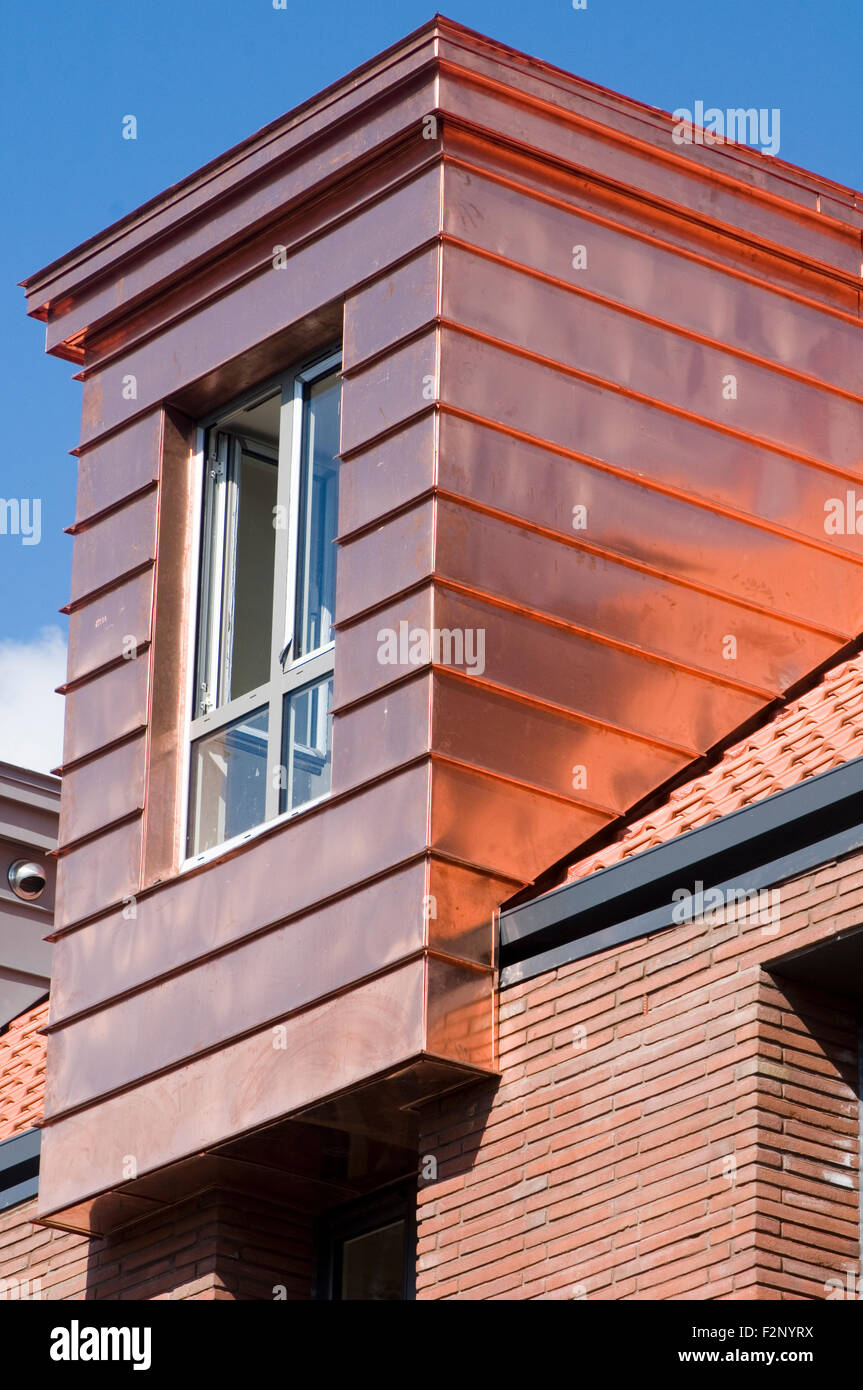 copper cladding orange gold green metal construction materials - Stock Image
