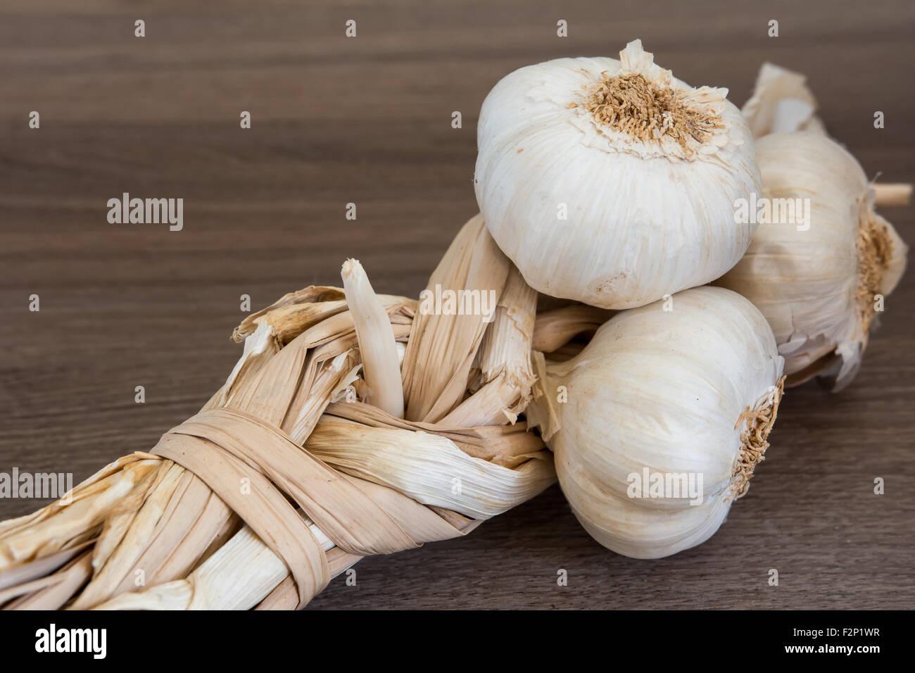 Organic garlic braid - Stock Image