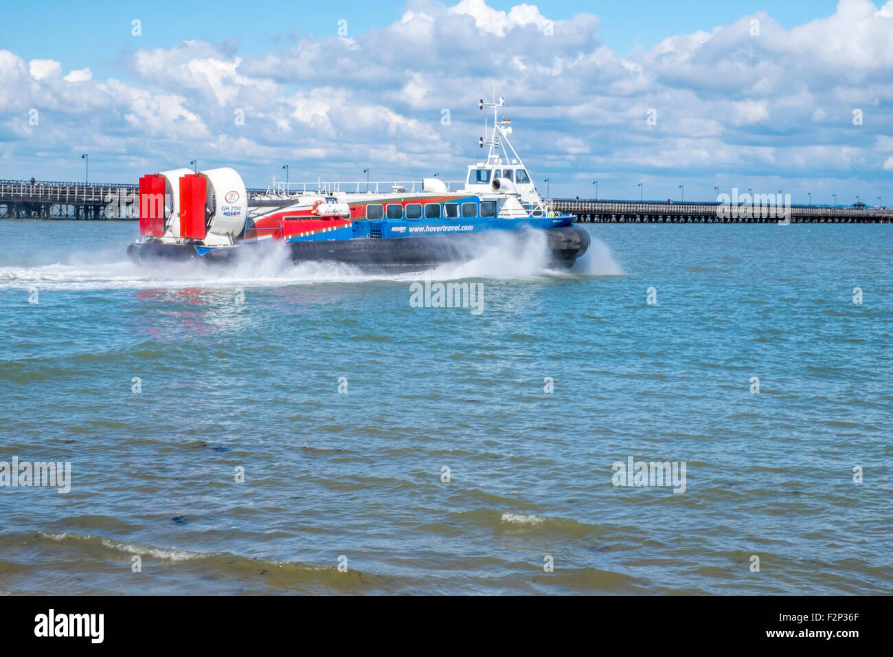 Hovercraft starting a journey floating onto the sea with large amounts of spray - Stock Image