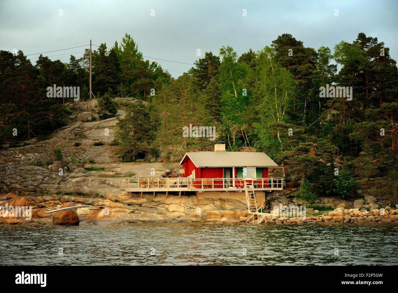 Helsinki, Finland. Summer house sauna with boat landing on coast on east side of Helsinki - Stock Image