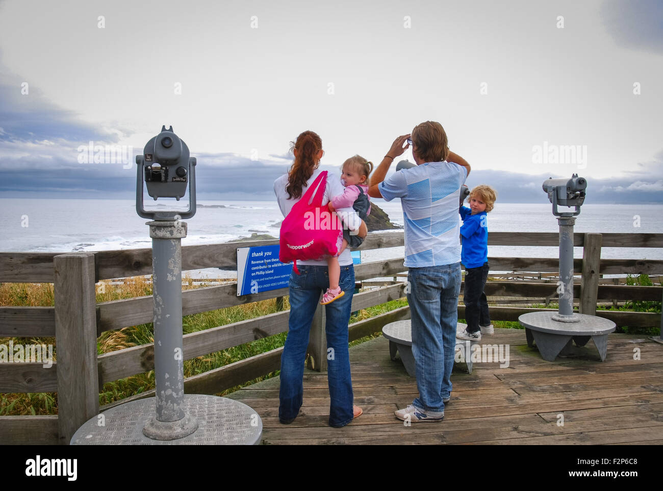 A family enjoys beach scenery from the viewing platform of Nobbies Centre. Stock Photo