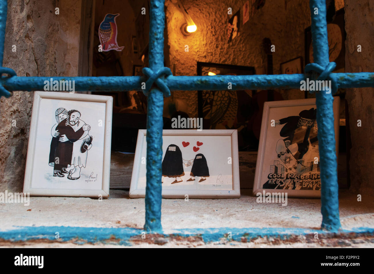Jaffa arts and crafts, hand made pictures, drawning, artist, Israel, muslim man, hug, jewish man, integration, coexistence, - Stock Image