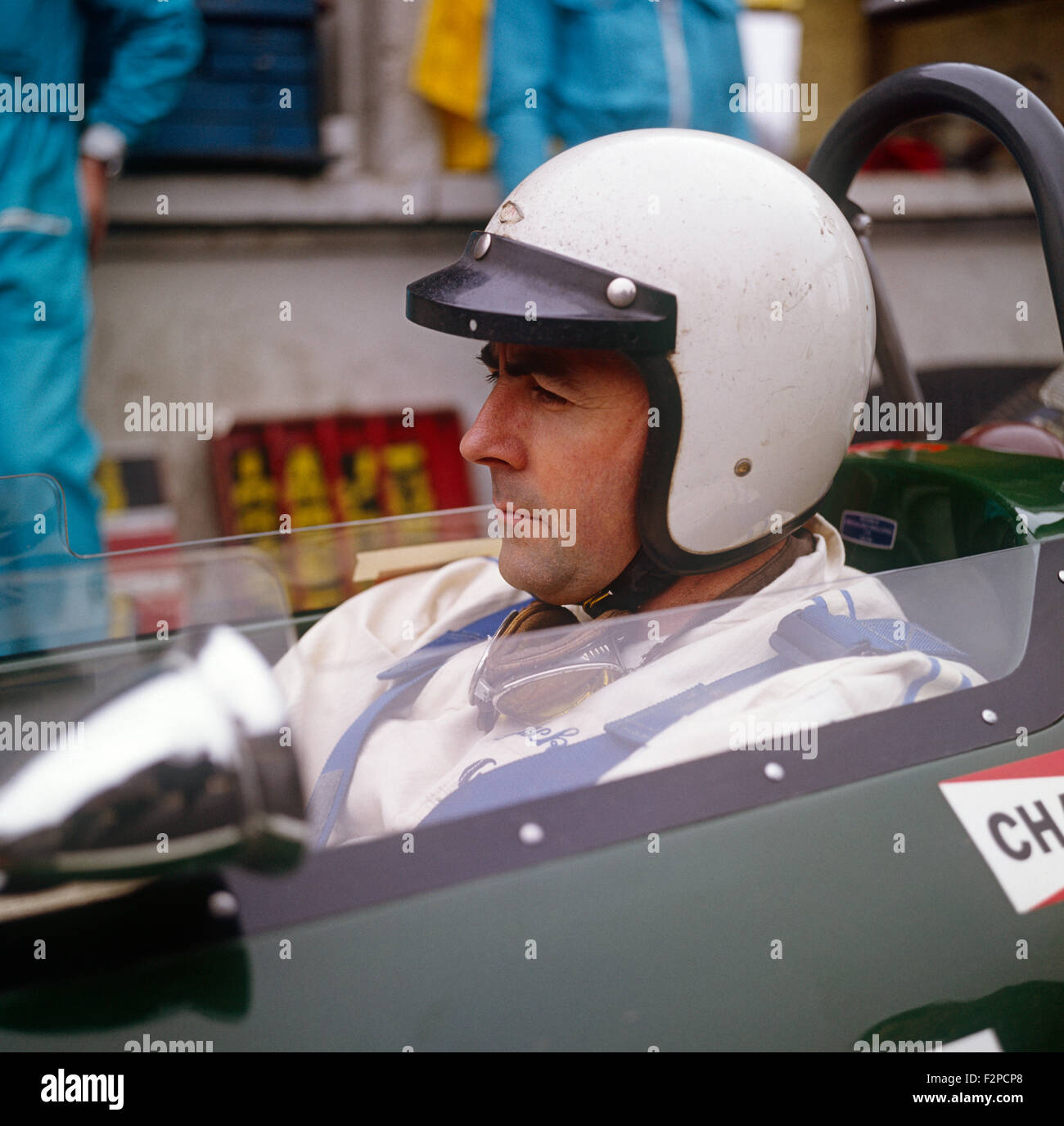 Jack Brabham sitting in the cockpit of his BRM 1960s - Stock Image