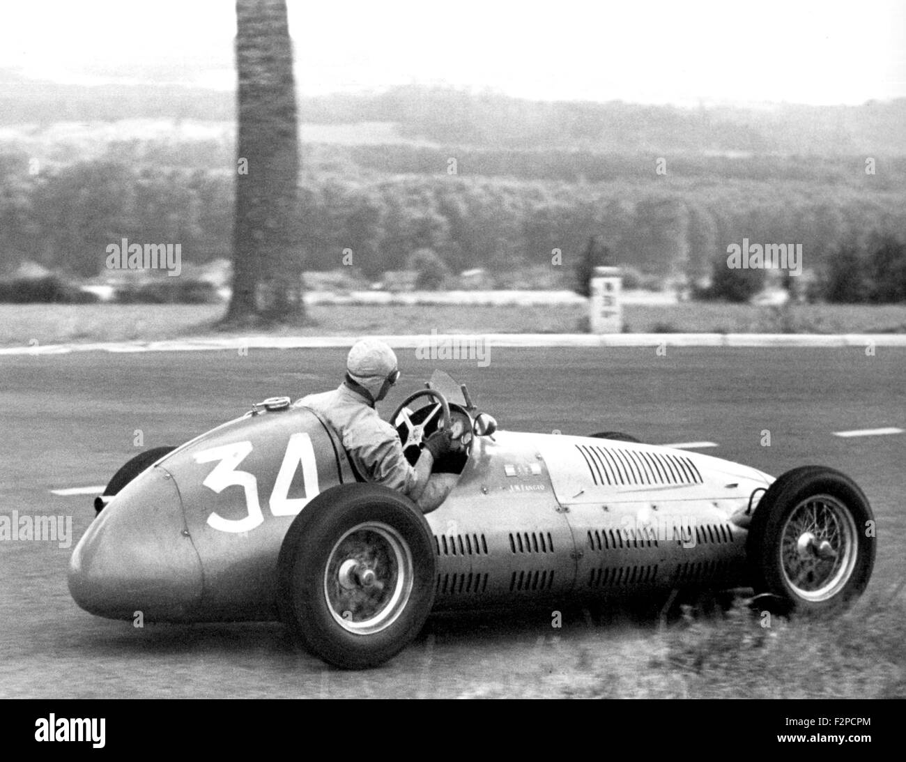 Juan Manuel Fangio in his Maserati 4CLT 1949 - Stock Image