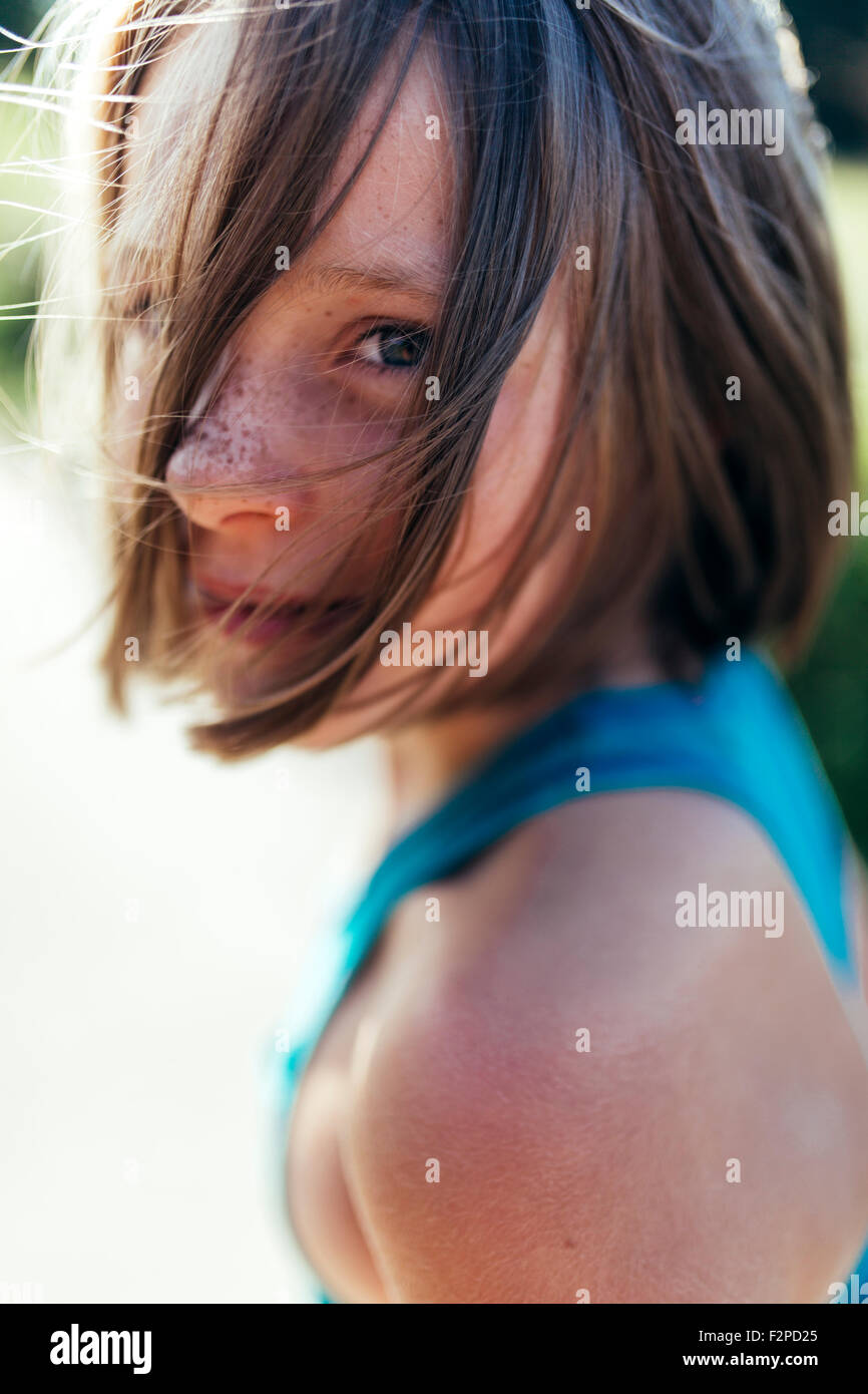 Portrait of girl with brown hair and freckles Stock Photo