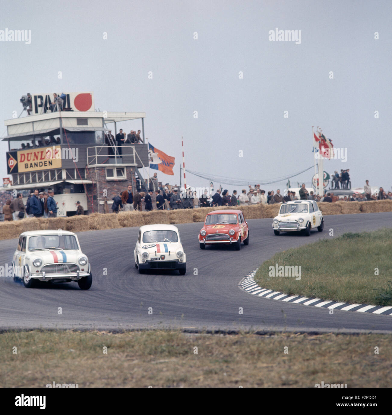 Mini Coopers and a Fiat 600 Abarth racing in the 1960s - Stock Image