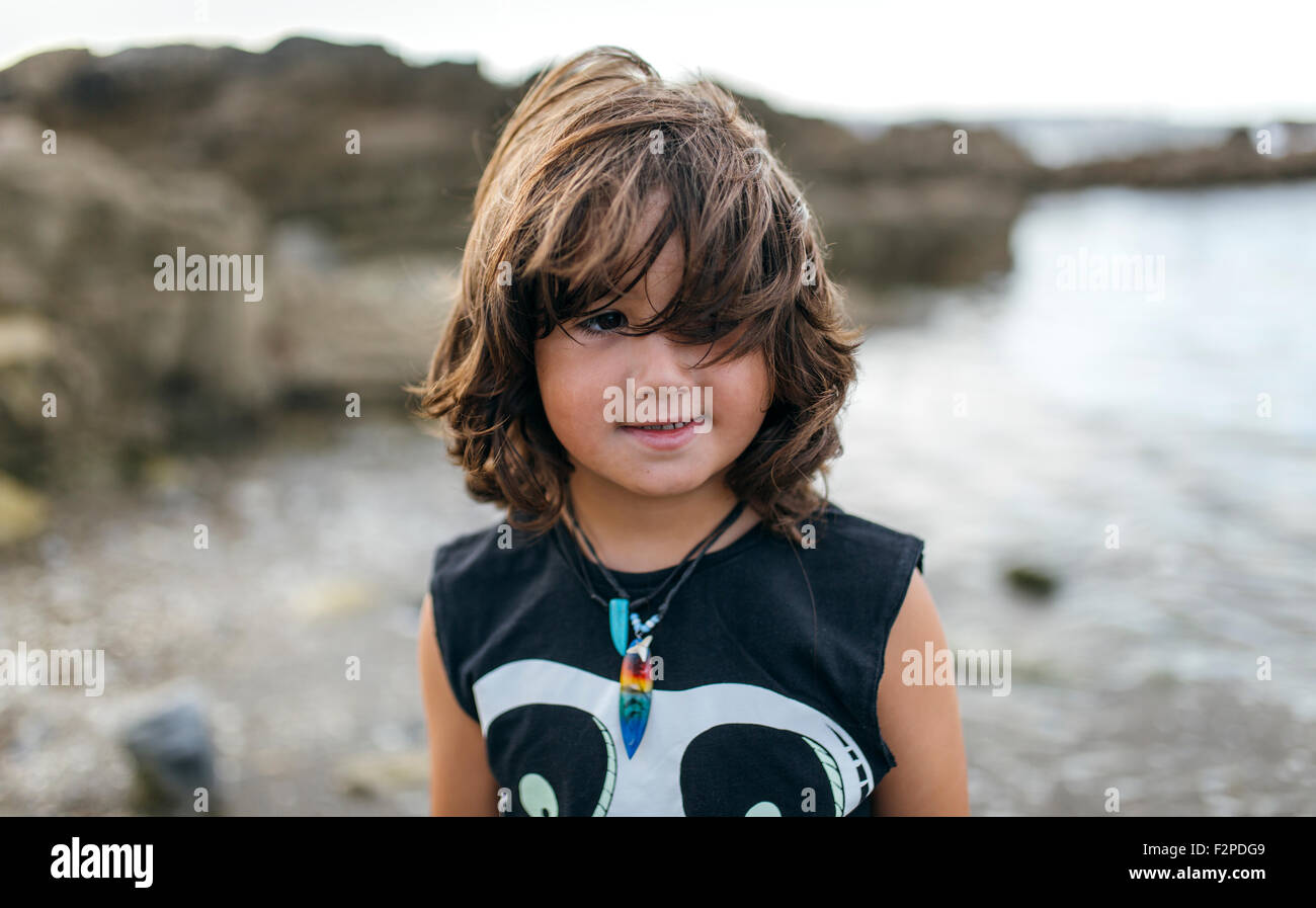 Spain, Gijon, portrait of little boy with brown hair on the beach Stock Photo