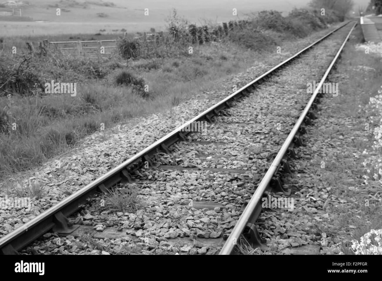 Deserted empty Railway track straight with no-one - Stock Image
