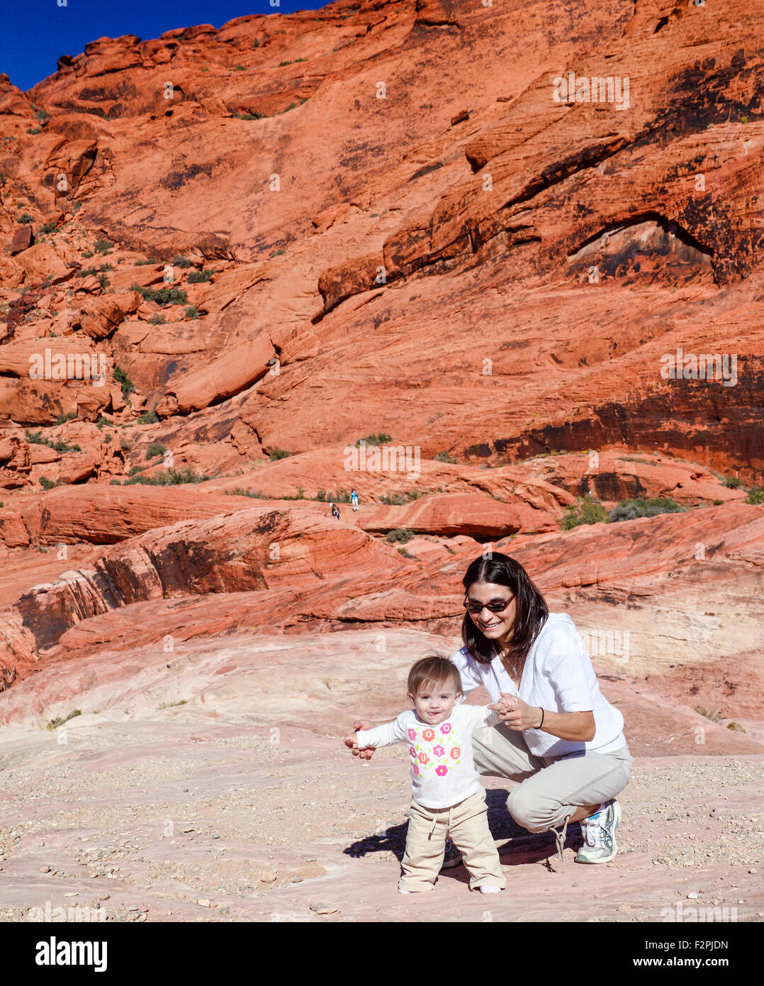 Mother and child at Red Rock Canyon National Conservation Area, about 20 miles from Las Vegas - Stock Image