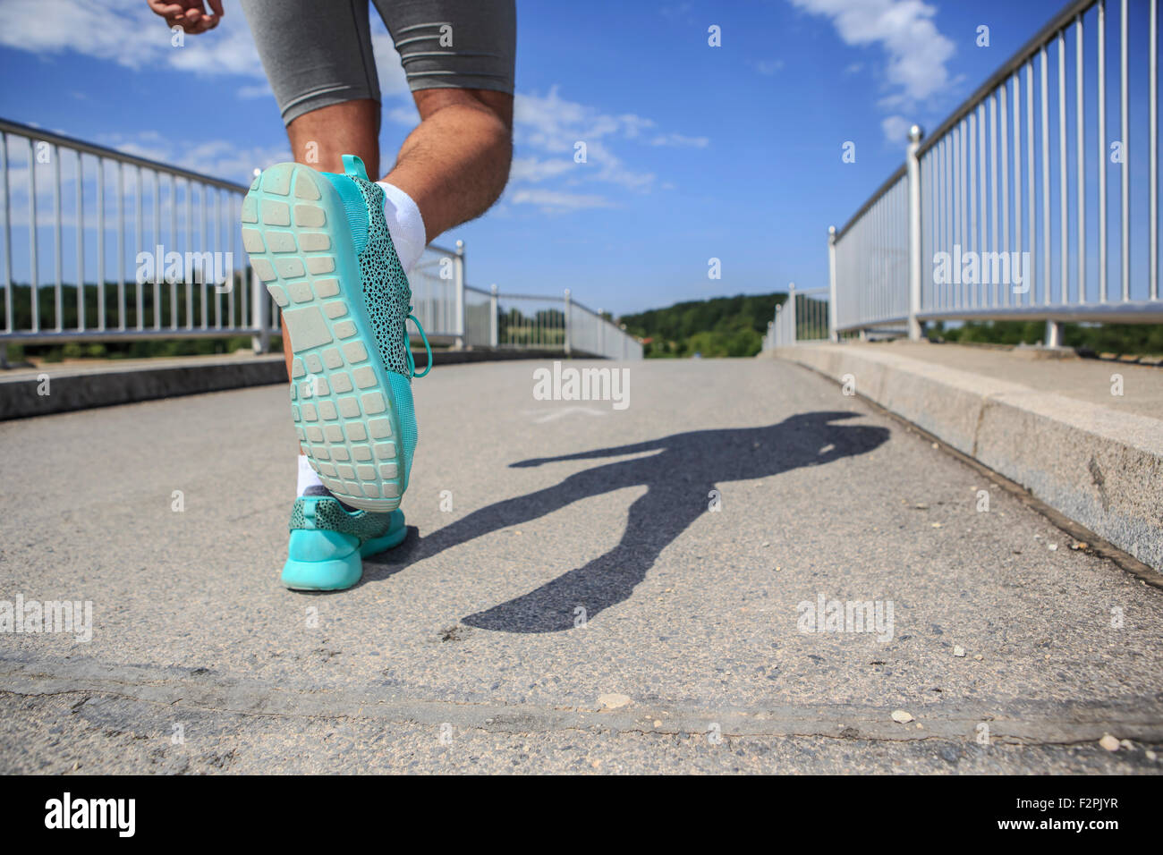 Young man at running exercise, sole Of shoe - Stock Image