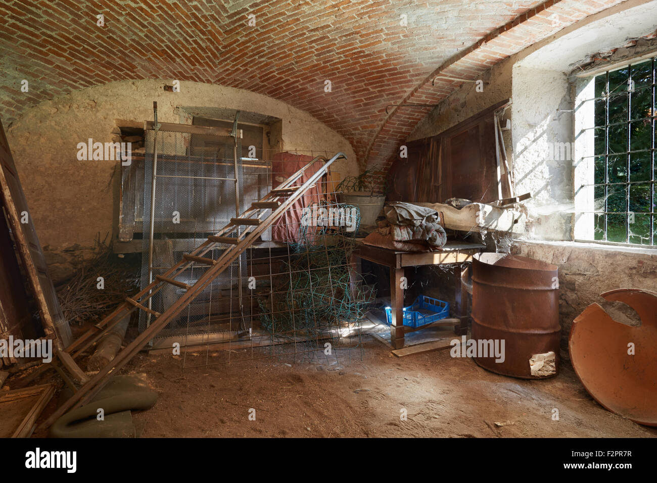 Old, messy basement in ancient house - Stock Image