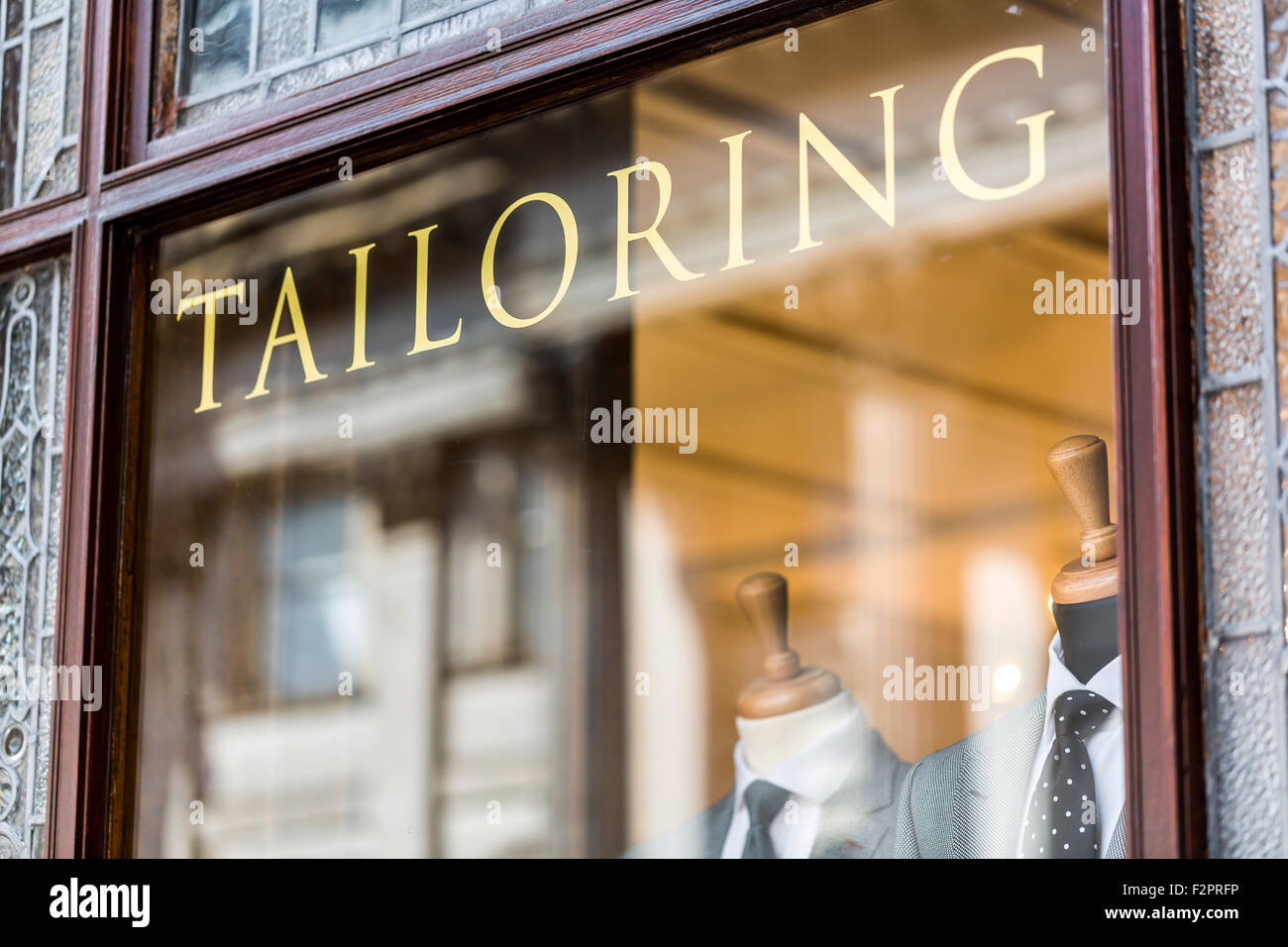 A tailoring sign on a shop window, Scotland, UK - Stock Image