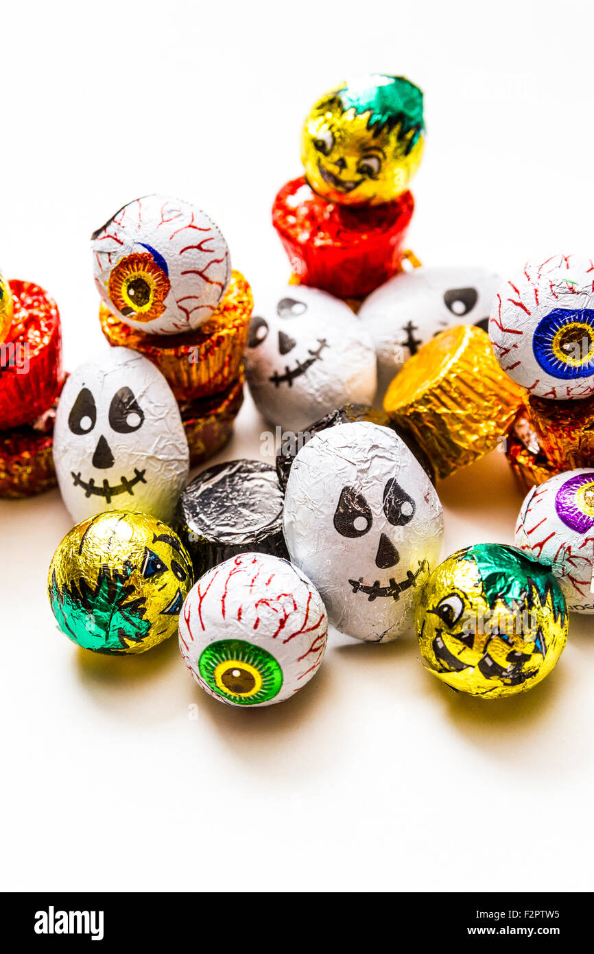 A pile of wrapped chocolate Halloween Candy - Stock Image