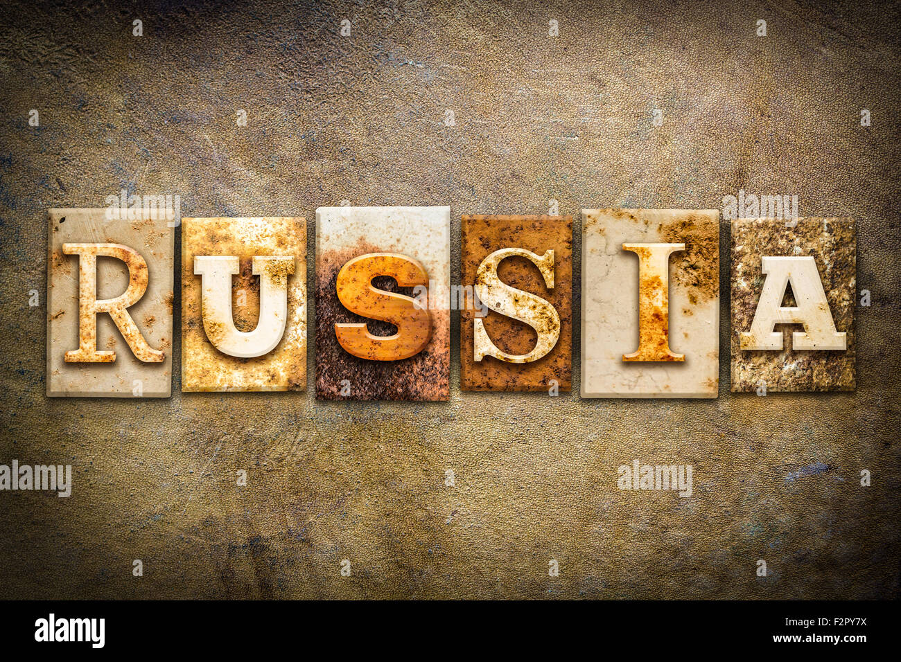 the word russia written in rusty metal letterpress type on an old aged leather