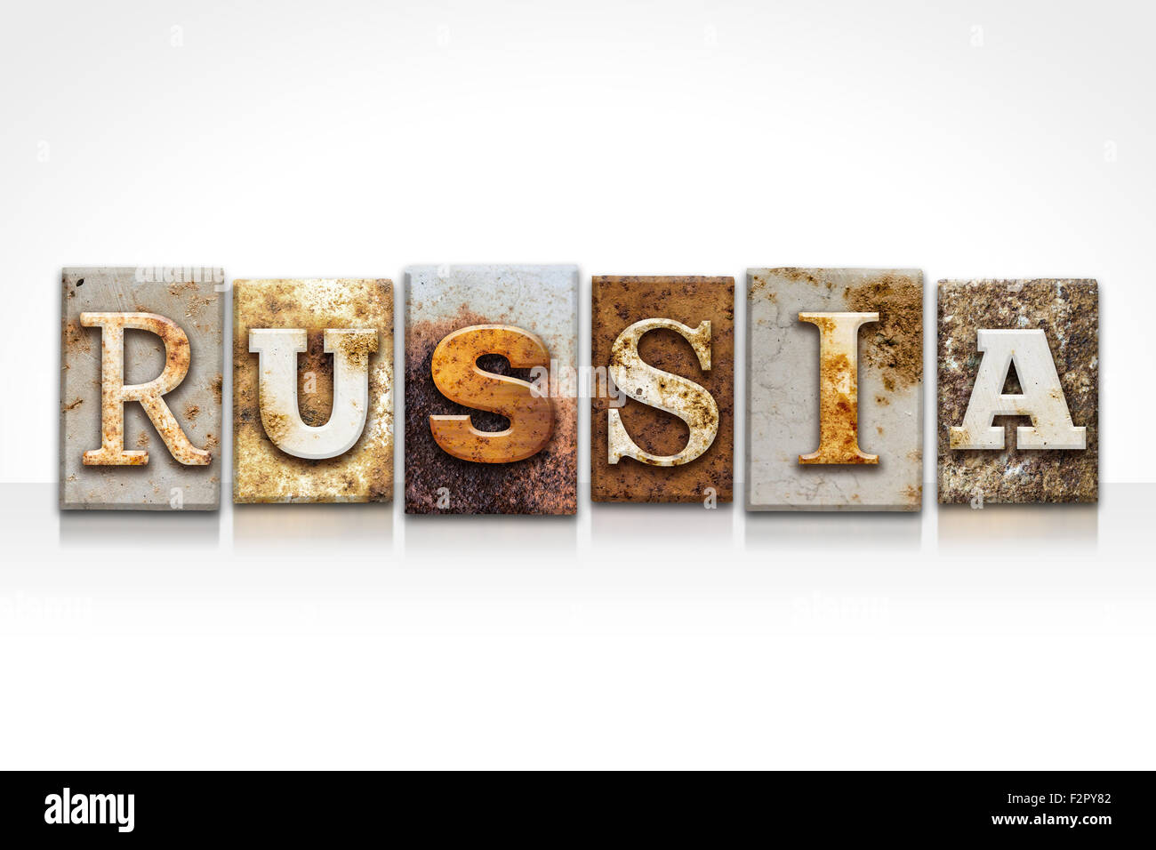 the word russia written in rusty metal letterpress type isolated on a white background