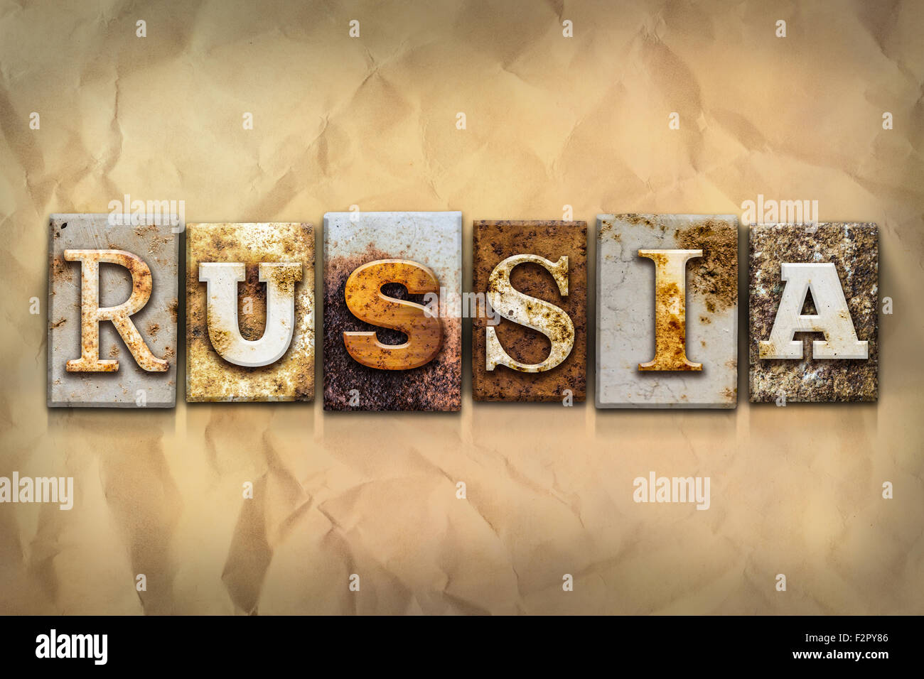 the word russia written in rusty metal letterpress type on a crumbled aged paper
