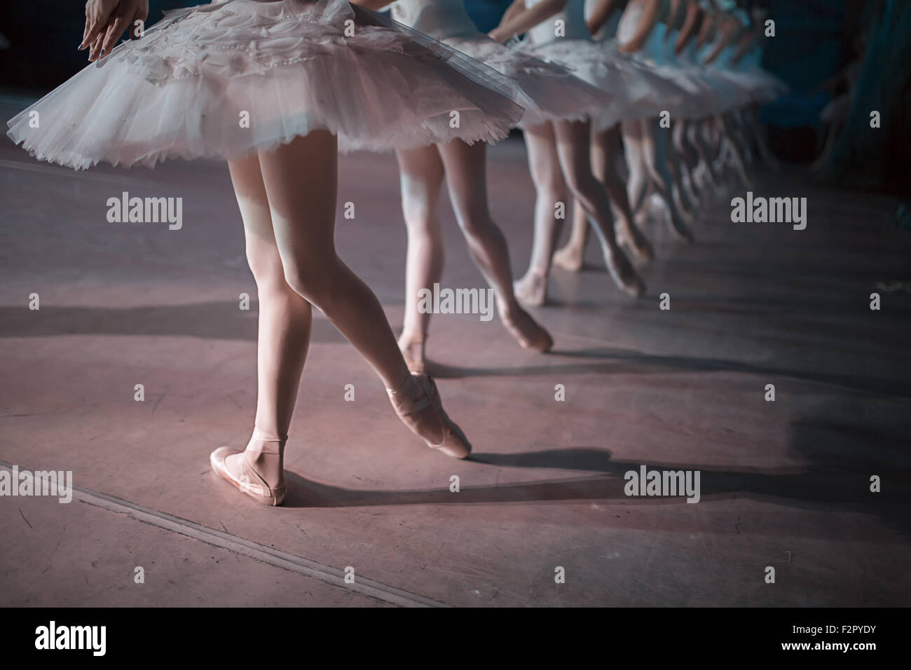 Dancers in white tutu synchronized dancing - Stock Image