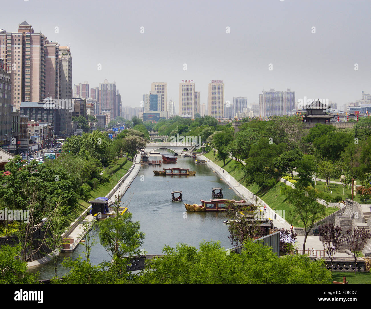 Xian, China, water way with backdrop of the city. - Stock Image