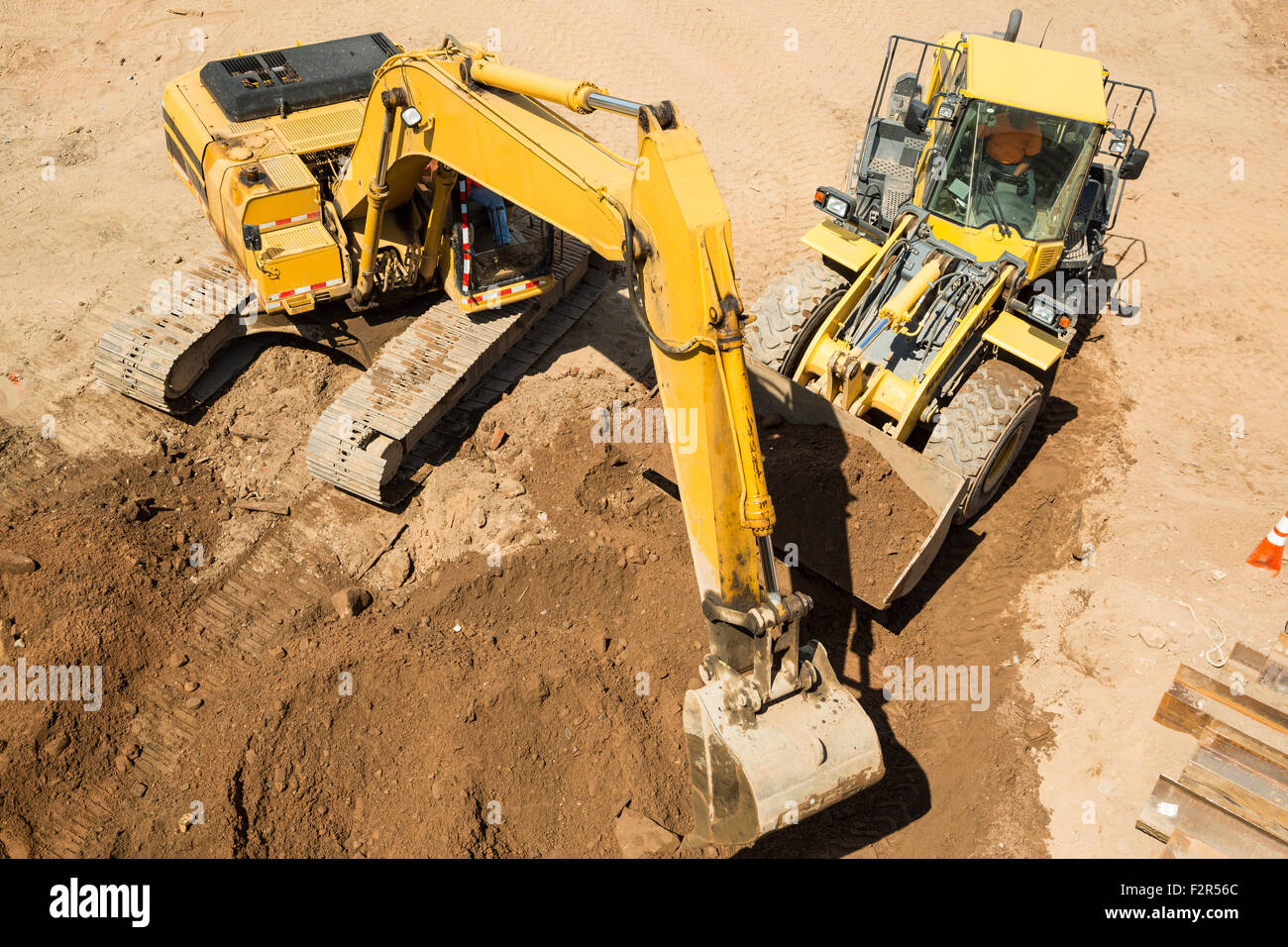 Construction site with a bulldozer and a excavator - Stock Image