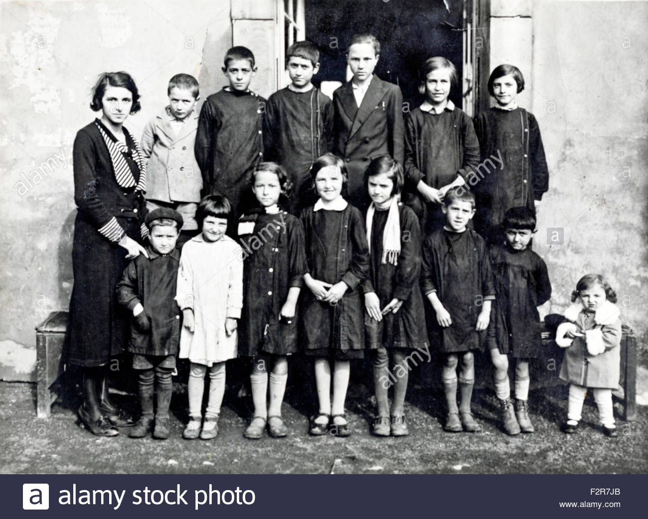 various aged school children and teacher rural France c 1930s Stock Photo