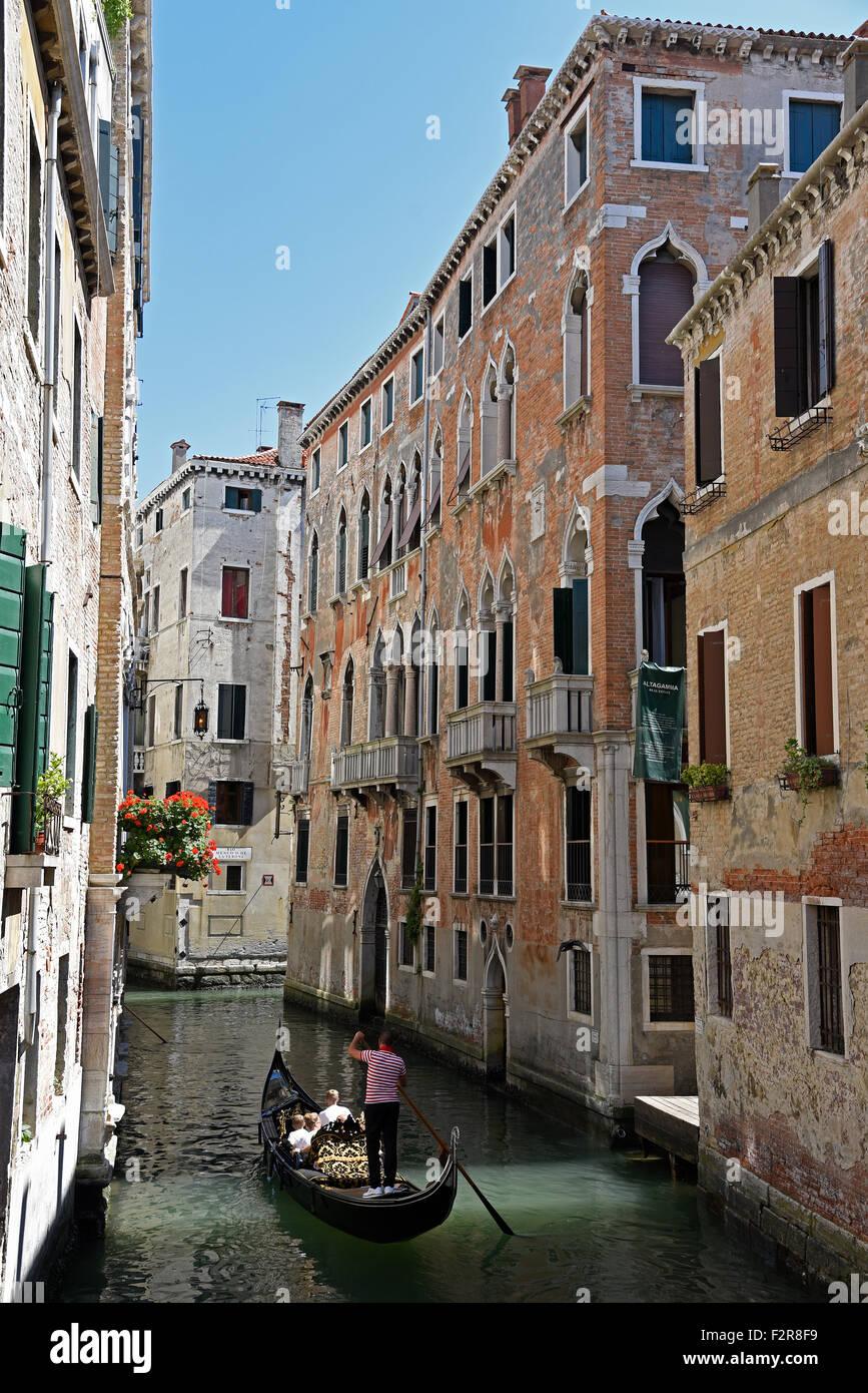 Gondola with gondolier on a canal, Venice, Venezia, Veneto, Italy - Stock Image