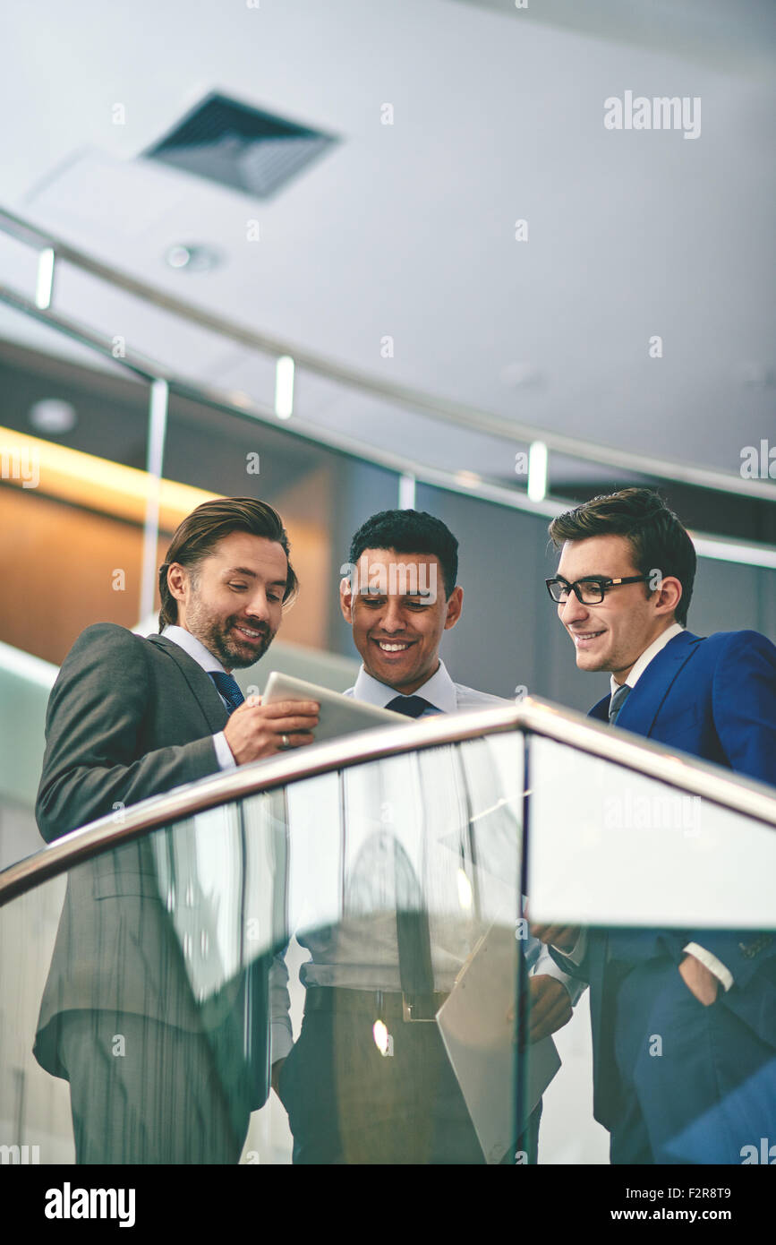 Group of businessmen planning work at meeting - Stock Image