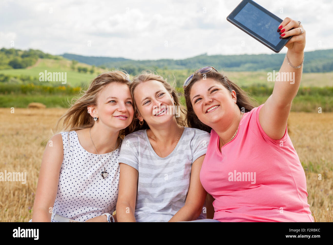 Three Best Friends Taking A Selfie Outdoors Stock Photo 87795216