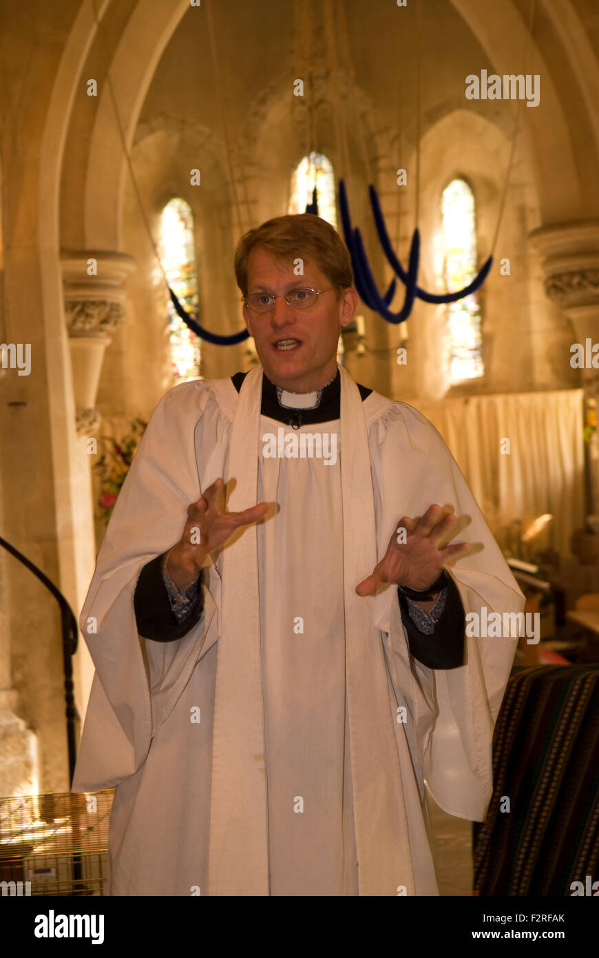 Vicar addressing the congregation during a Sunday morning service, Bramshott, near Liphook, Hampshire, UK. Stock Photo