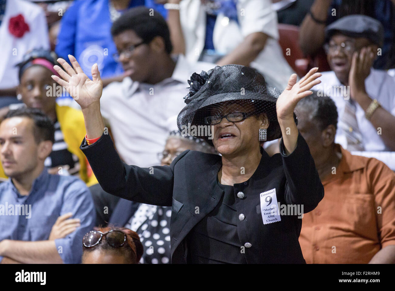 A mourner stands for a hymn during the funeral of slain State Senator Clementa Pinckney at the TD Arena June 24, Stock Photo
