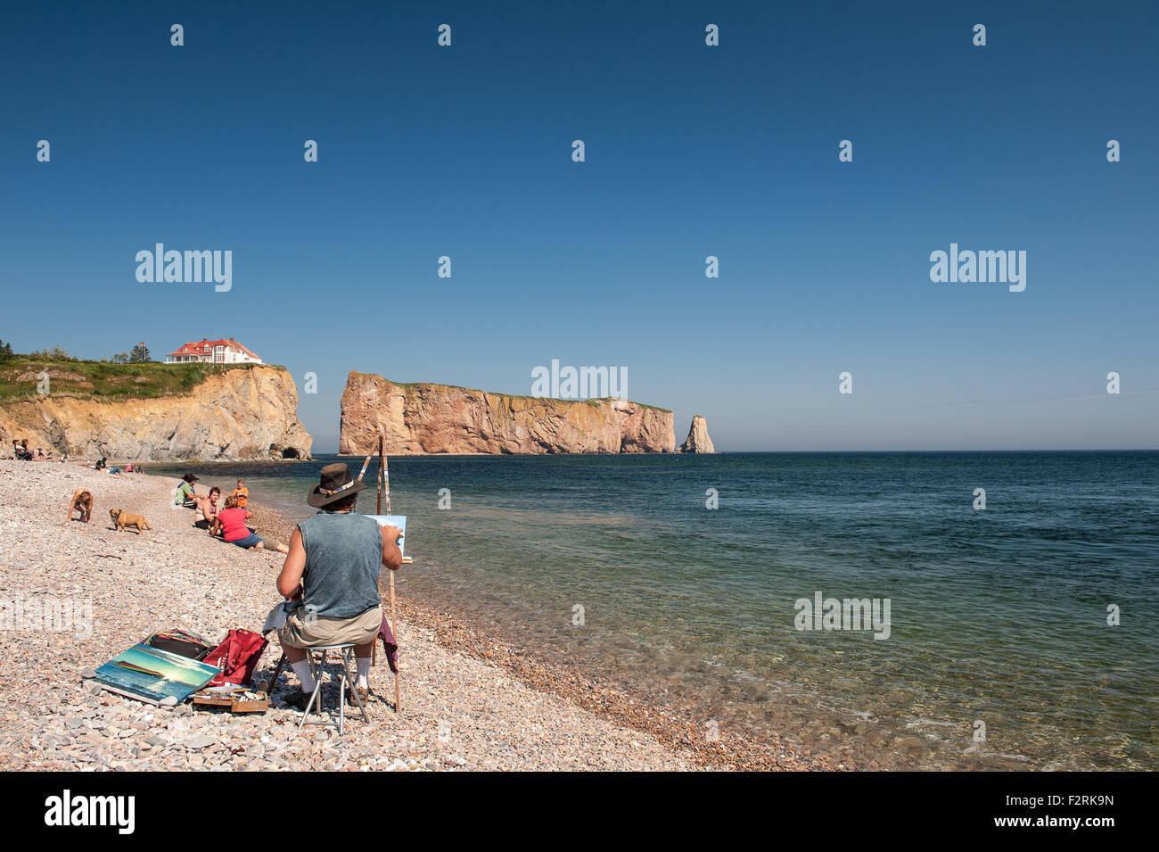 Landscape painter painting  Perce Rock in the Gulf of St Lawrence, Gaspe Peninsula - Stock Image