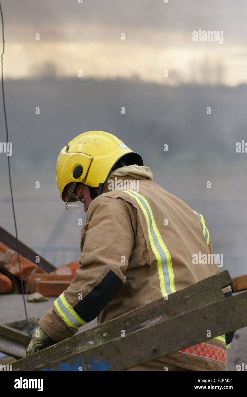 fire fighter at disaster zone - Stock Image