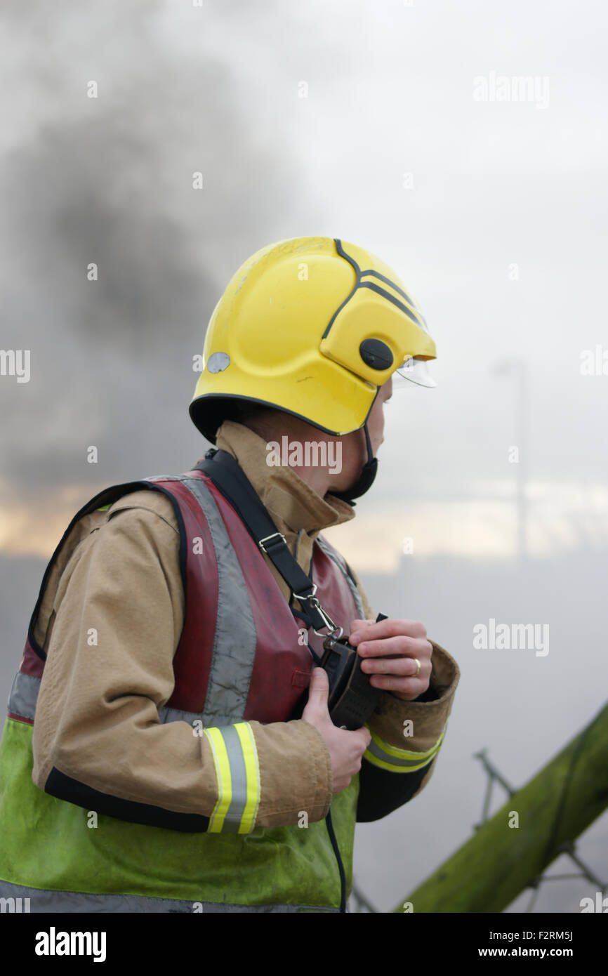 fire fighter at explosion, disaster zone - Stock Image