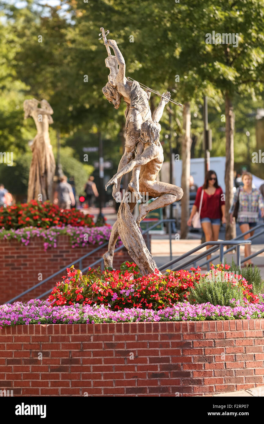 Reminiscence by sculpture Tuan along Main Street in downtown Greenville, South Carolina. - Stock Image
