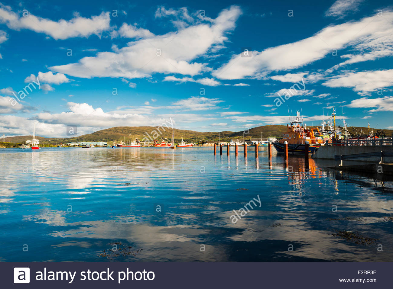 The harbour at Castletownbere, a fishing town on the Beara peninsula, west Cork, Ireland, with Bere Island in the - Stock Image