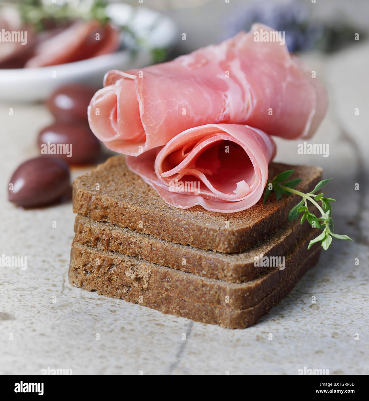 Appetizer,Rye Bread ,Cold Cuts and Olives Stock Photo