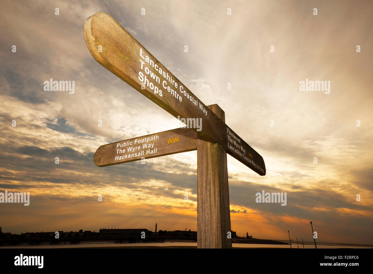View across to Fleetwood; street signs to different destinations. Lancashire Coastal Way Signpost, at Knott End, - Stock Image