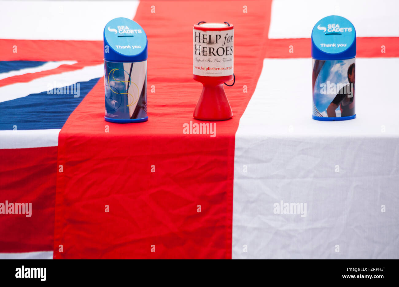 Charity collection tins for Help for Heroes and Sea Cadets at Waterfest festival, Weymouth in September - Stock Image