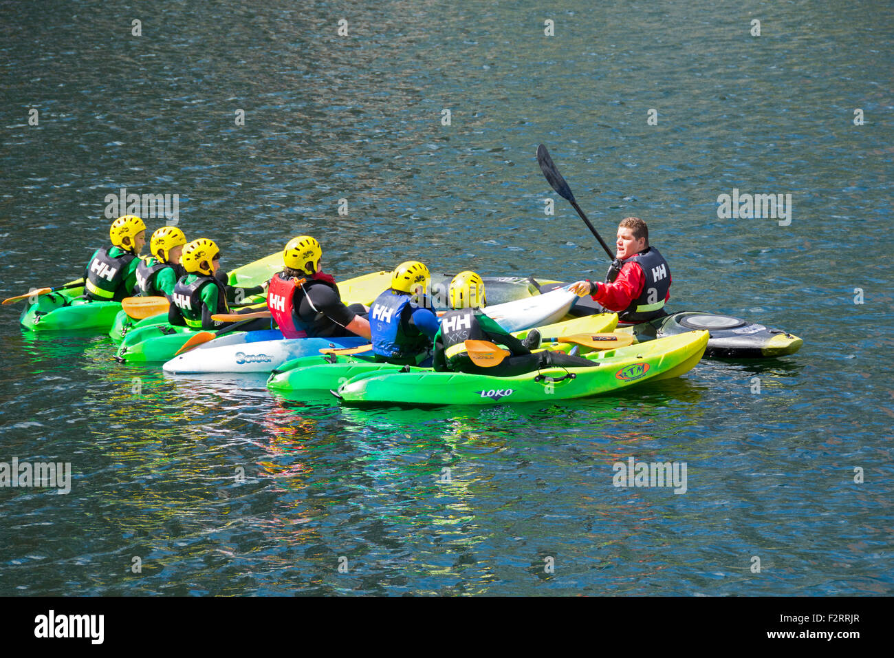 Children undergoing kayaking tuition at Huron Basin, Salford Quays, Manchester, England, UK - Stock Image