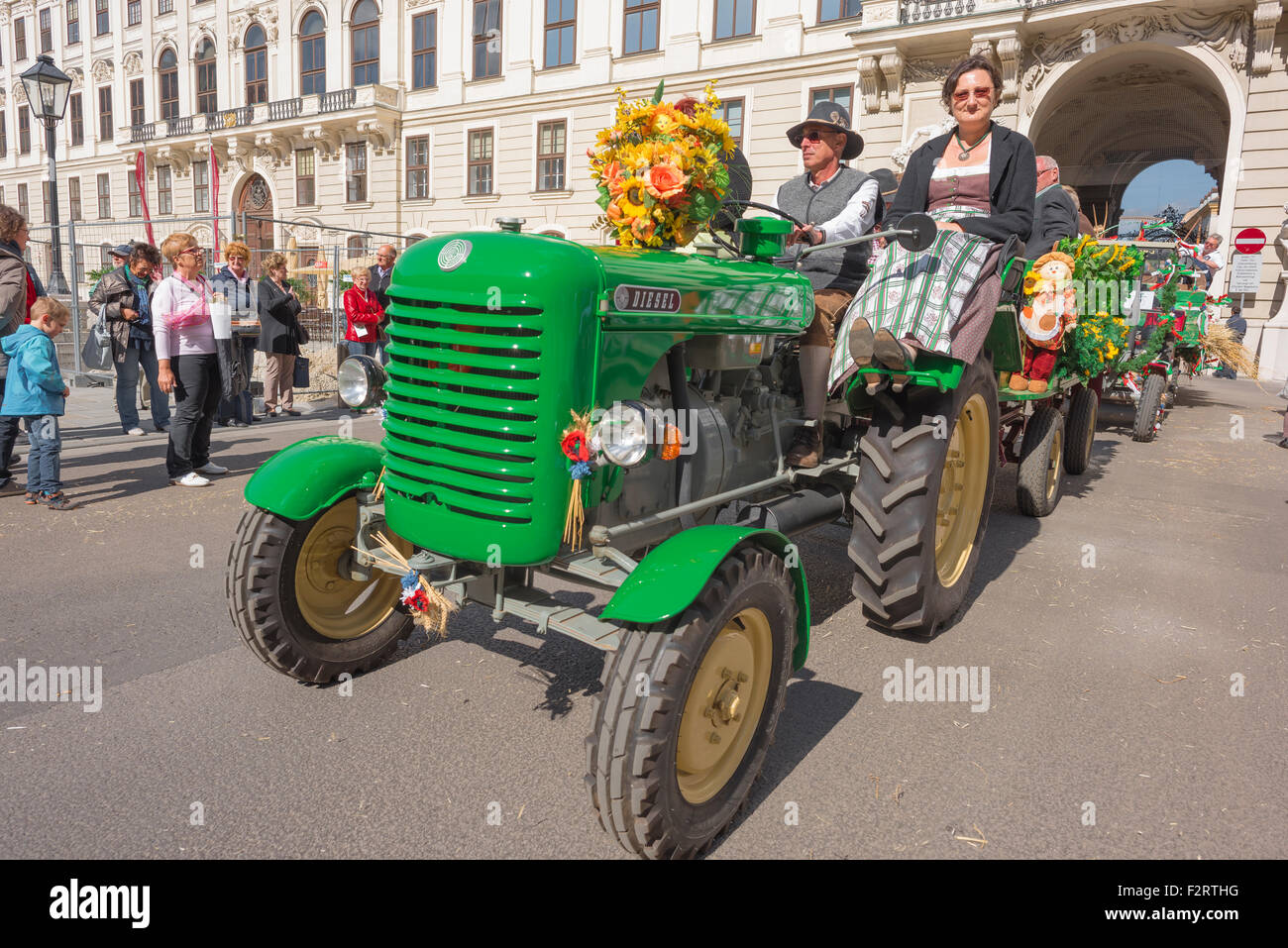 Austria farmer tractor, at harvest festival in Vienna a farmer drives his tractor into the courtyard of the Hofburg - Stock Image