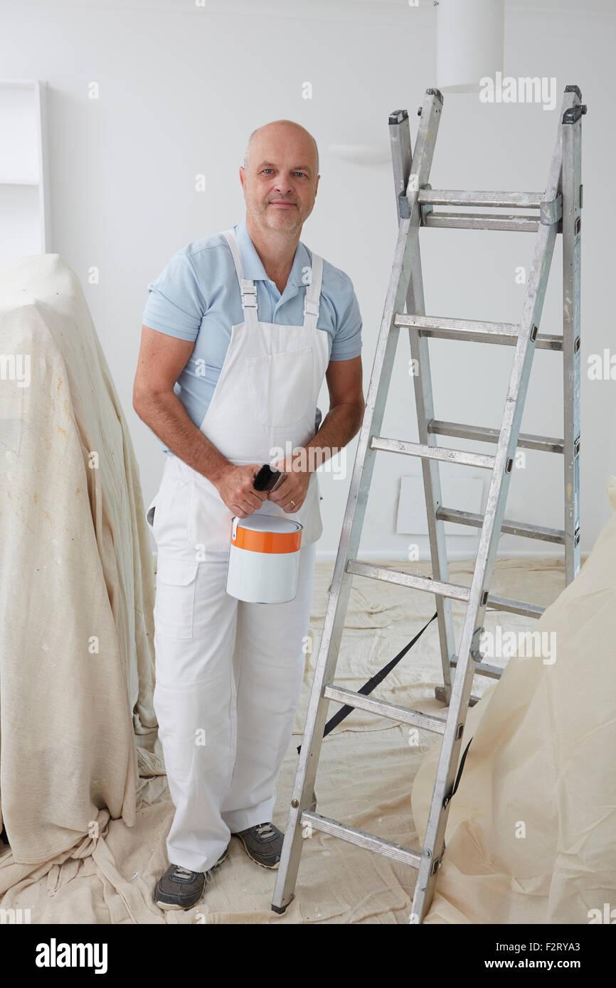 Portrait Of Decorator Painting Room - Stock Image