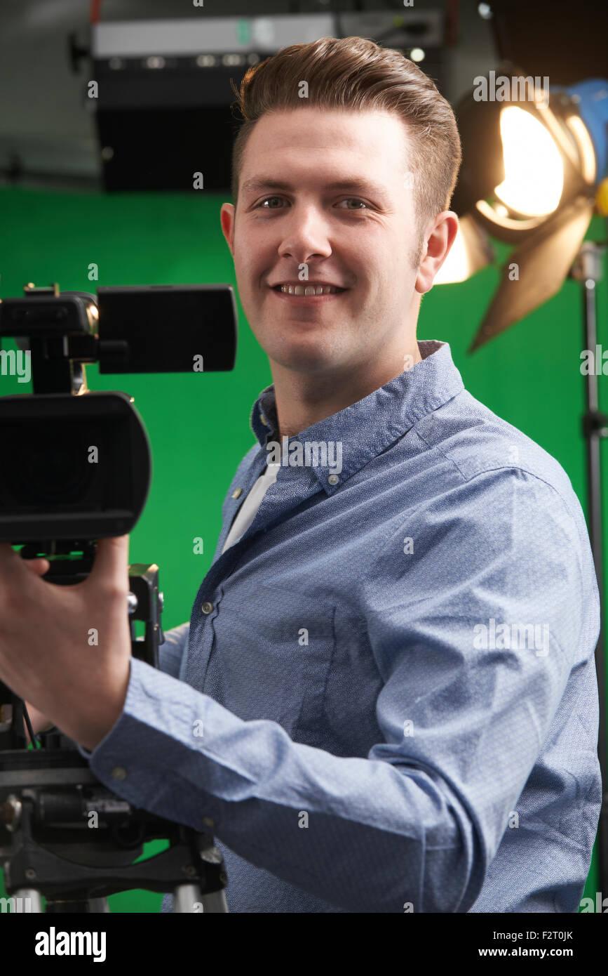 Portrait Of Cameraman Working In Television Studio - Stock Image