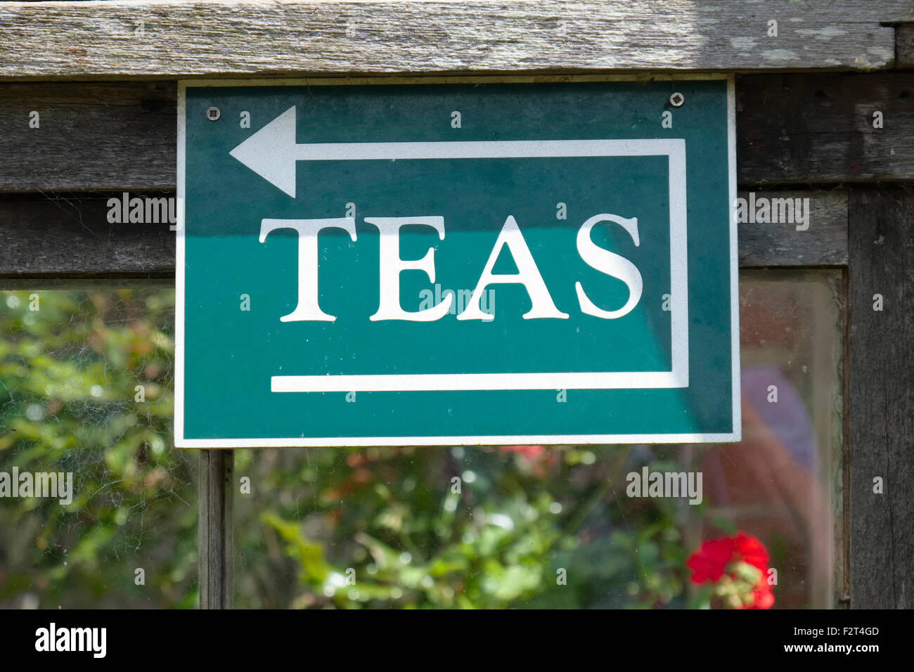 Sign with Arrow Pointing to Tearoom in Open Gardens - Stock Image